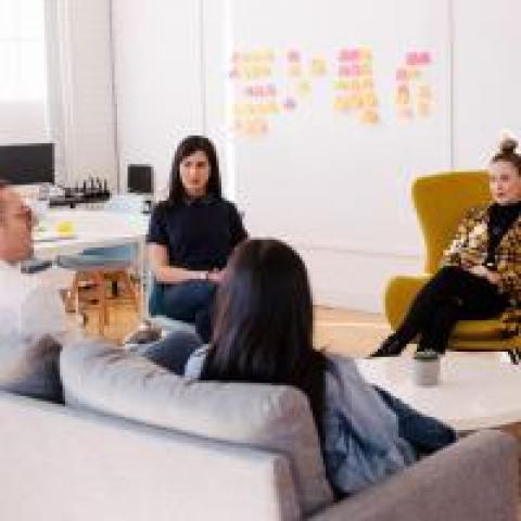 ScrumMaster facilitating communication between an agile team and stakeholders