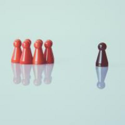 Game pieces with a leader facing the other pieces