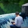 man working near waterfall